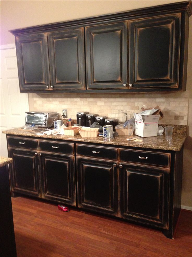 25+ best ideas about Black distressed cabinets on