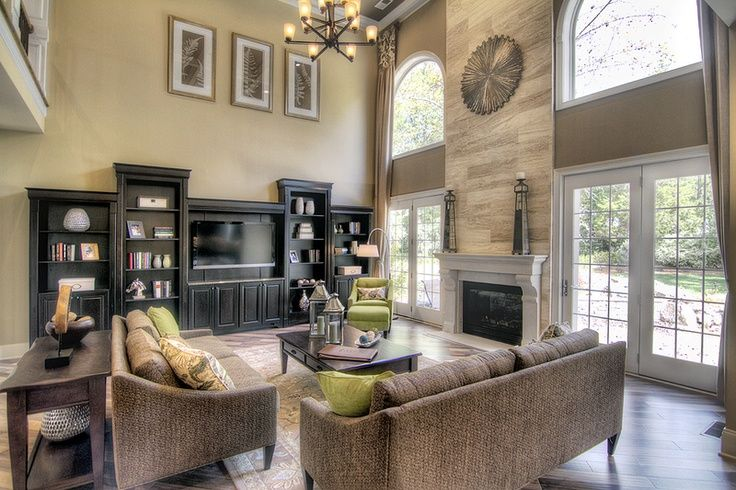 two story great room with windowsdoors beside fireplace