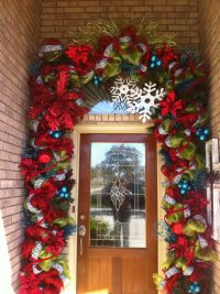 Incredible garland around front door!