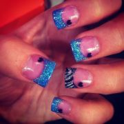 acrylic nails with blue sparkly
