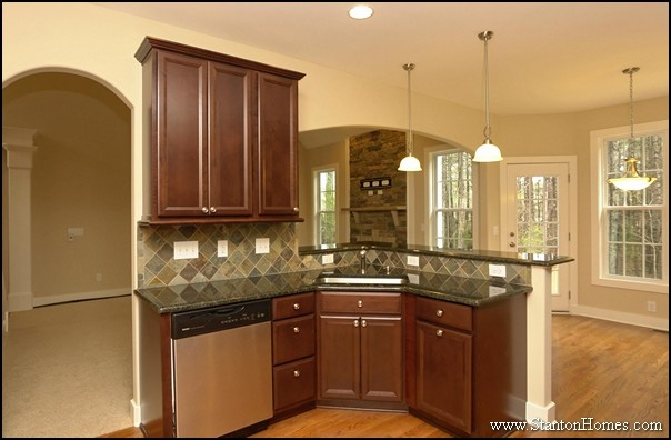 New home kitchen layout angled island with raised eating