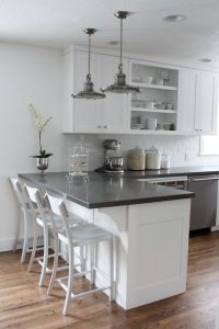 This is it!!! White cabinets, subway tile, quartz