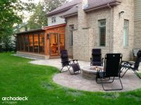 Screen porch and patio, featuring a fire pit, fireplace ...