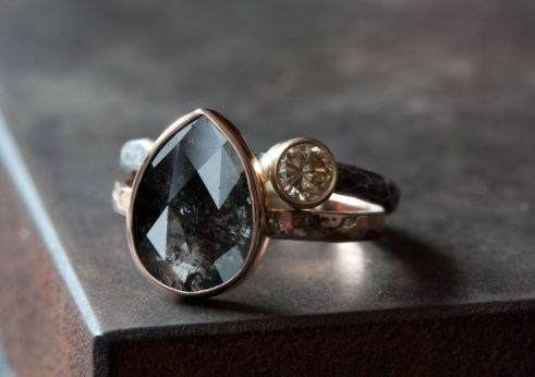This stunning, natural, black rose cut diamond is a one of a kind beauty!! Diamond has gorgeous natural shimmer and beautiful contrast with this rose gold setting. Wrapped in a beautiful 14kt rose gold bezel and band, with a hammered finish. Looks lovely stacked with another band or diamond, or simply worn alone. The perfect non-traditional engagement ring!