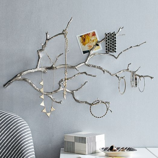 Hang earrings necklaces and bracelets from the silver branches of this Manzanita Wall Jewelry