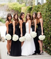 Mismatched black bridesmaid dresses with white hydrangea ...