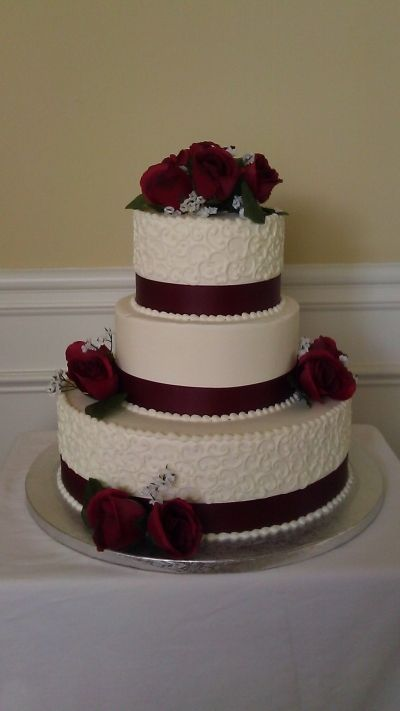 Elegant Buttercream And Maroon Scrolls By