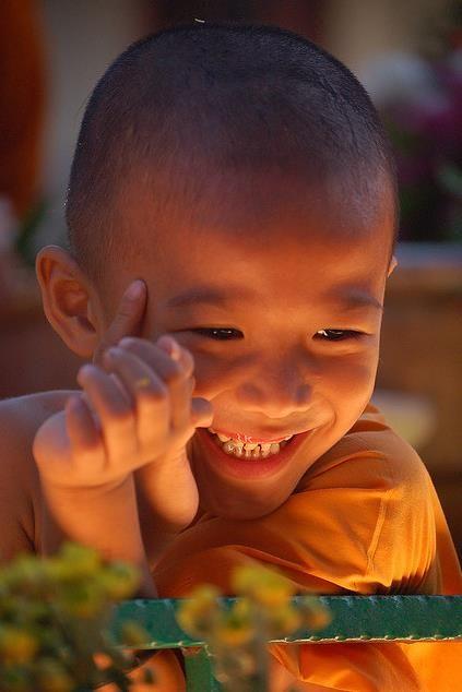 Joy: Glowing smile.