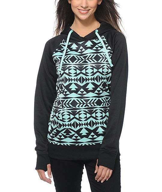 A trendy black and mint tribal print body is accented by a solid hood, raglan sleeves and trim, while the soft fleece lining