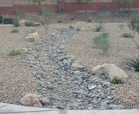 river rock patio landscaping