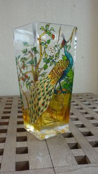 This decorative glass painted vase may also use as a ...