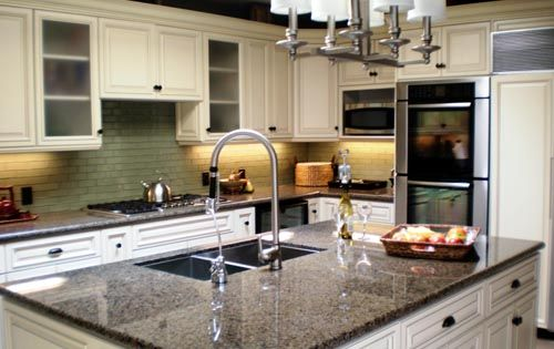 White Cabinets With Granite Countertops With Patina