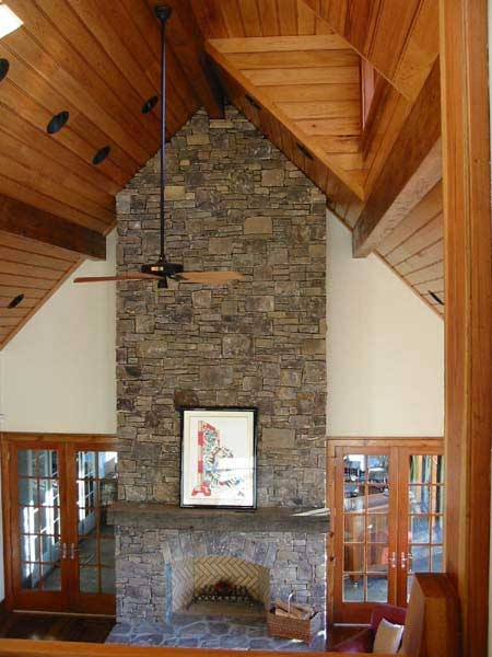 Cathedral ceiling and stone fireplace