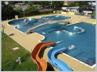 Cool outdoor swimming pool with water slides | Pools ...
