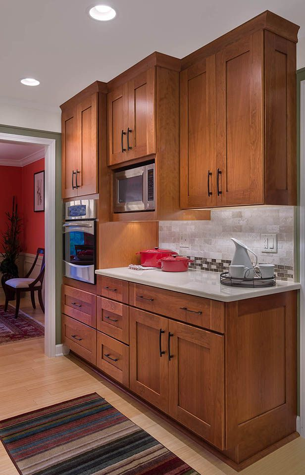 COLORS Microwave in cabinetry  under mounted lighting Must have white quartz countertop