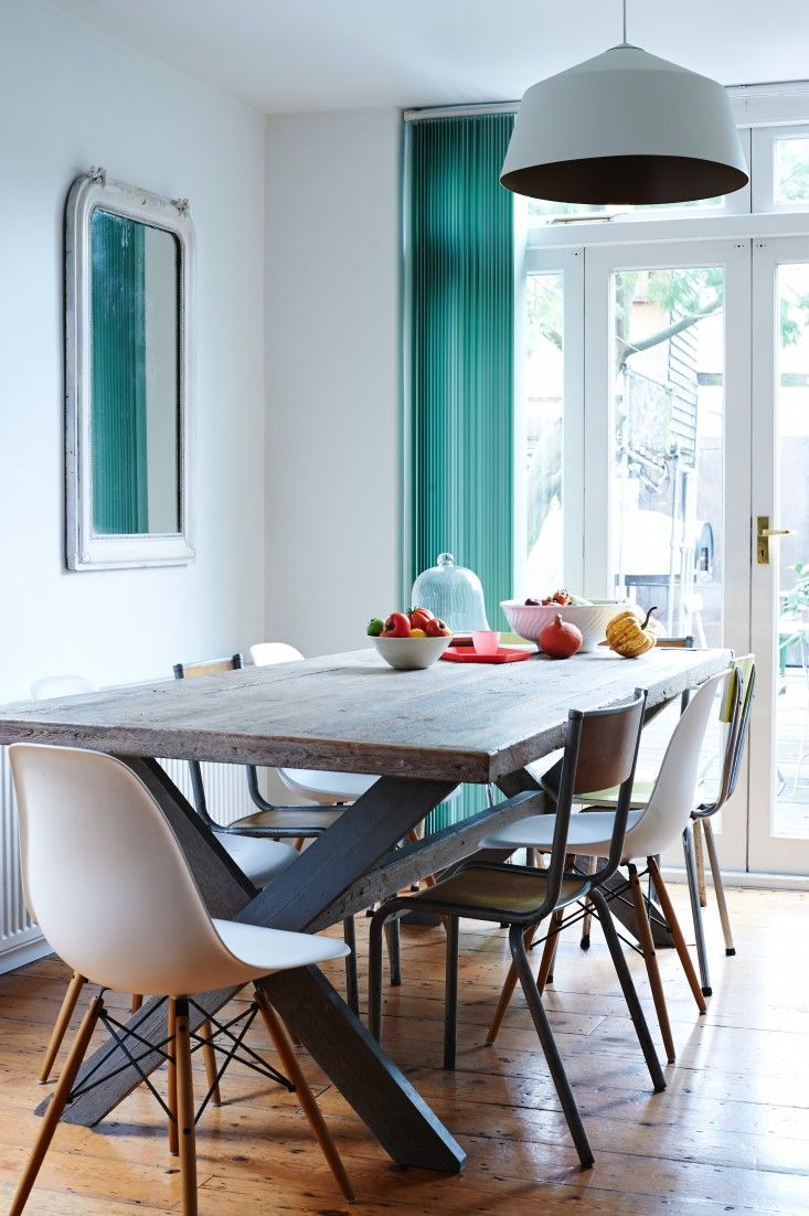Wood dining room table and teal curtain with white Eames