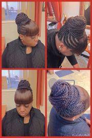 cornrows in bun with bangs; fabulous