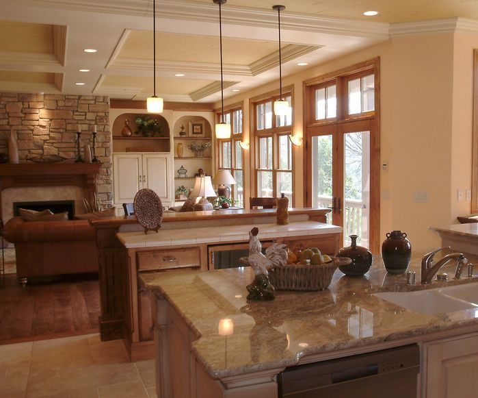 Large, open concept country/rustic kitchen by Ware Design