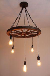 25+ best ideas about Wheel chandelier on Pinterest   Wagon ...