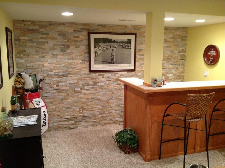 Natural stone wall behind basement bar  Natural Stone