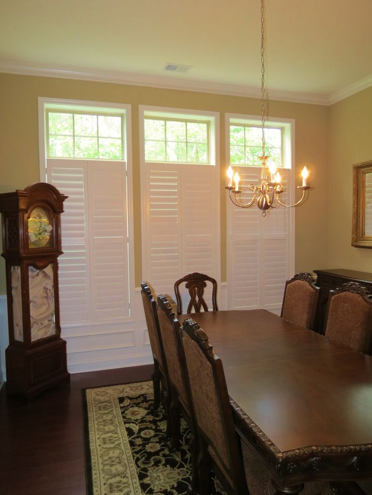 Plantation shutters with open transom in a dining room
