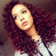 curly black hair with red highlights