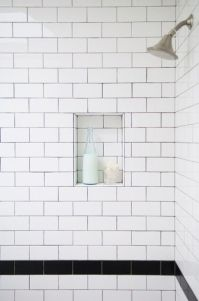 White subway tile with black trim in shower stall ...