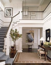 This large front hall with open stairs, beautiful woodwork ...