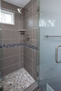 Grey porcelain tile was chosen for the floor, shower walls ...