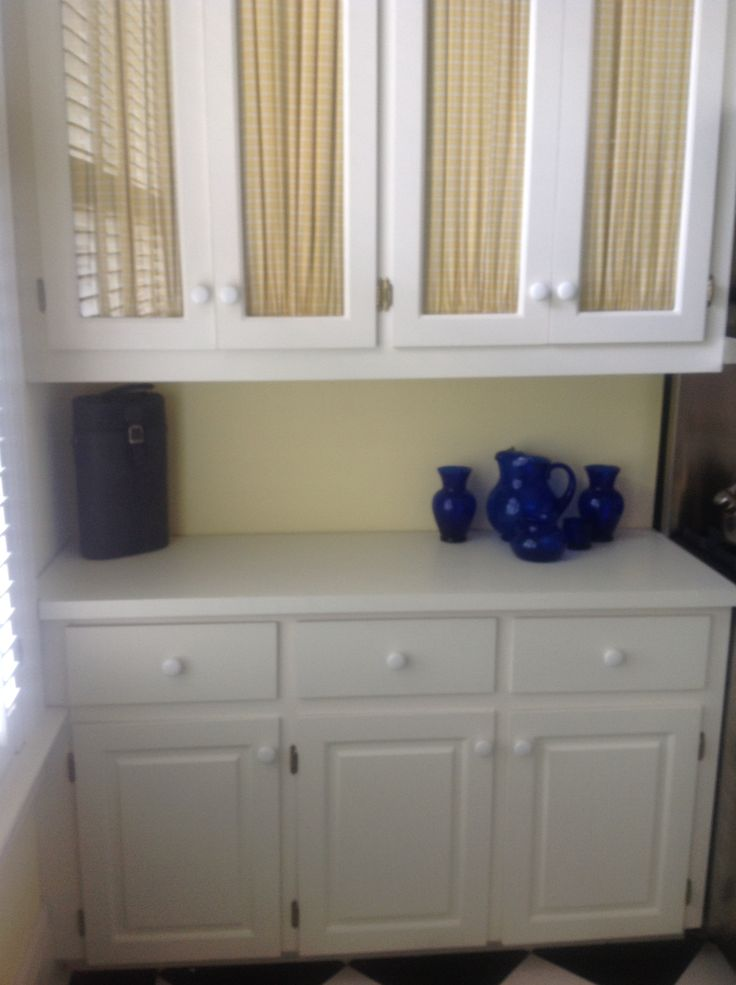 Cabinets with glass and fabric inserts  For the Kitchen