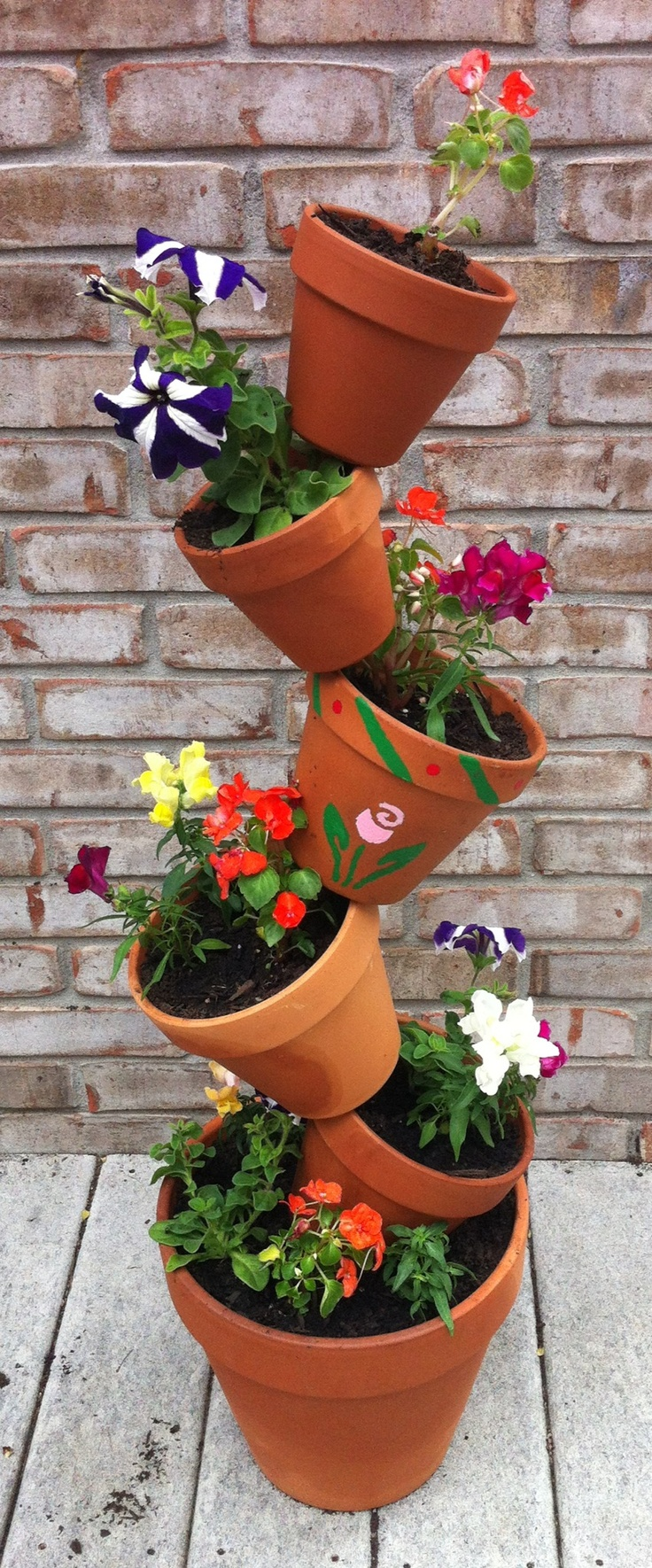 The 25 Best Ideas About Flower Pot Tower On Pinterest Stacked