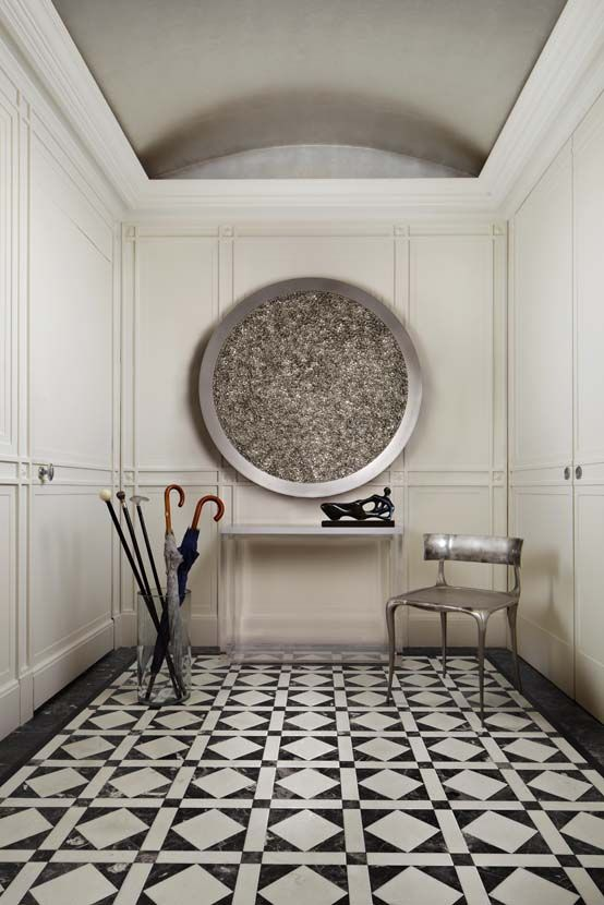 entry hall in nyc apartment black white tile floor love