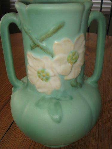 antique white kitchen cabinets concrete countertops vintage weller pottery vase matte green dogwood/wildrose ...