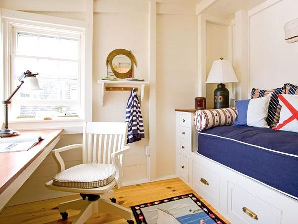 With a builtin desk and day bed this multipurpose nauticalthemed room serves as both a home