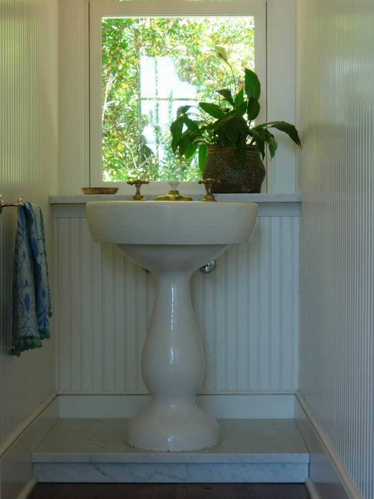 Elevate your antique pedestal sink by building a platform Bring it up to the height that feels