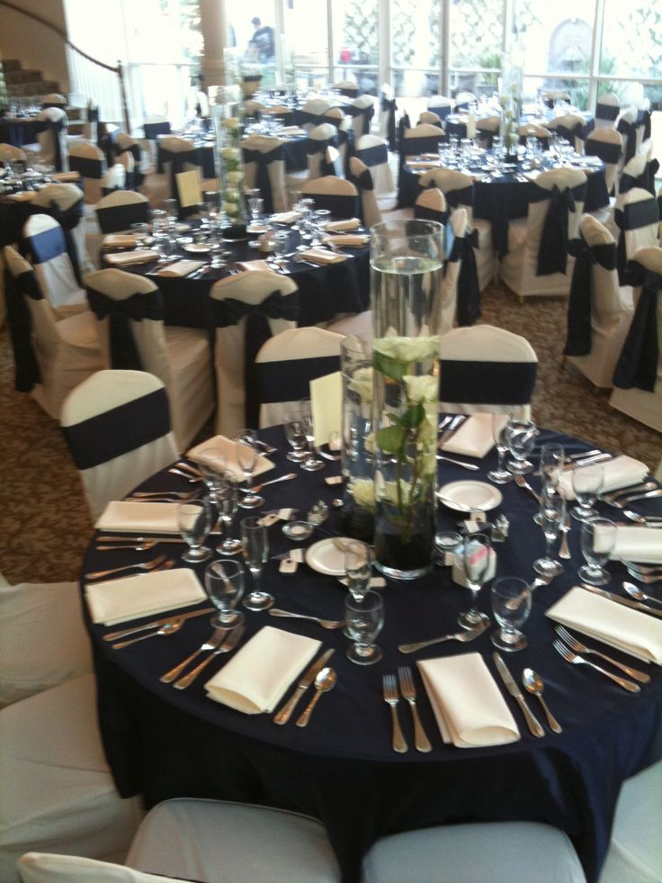 Our Ivory tablecloth under our satin navy overlays with
