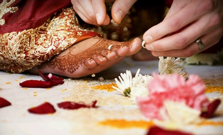 Groom putting toe rings in Indian Bride I cant wait till this day  Traditional Indian