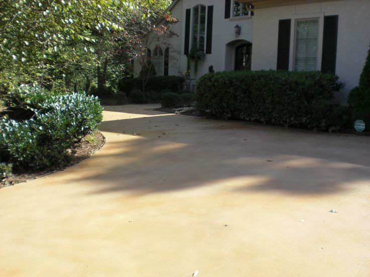 Semitransparent concrete stain in Desert Flagstone  Natural Henna gave this driveway a subtle distressed finish  Driveways with Colorseal
