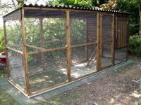 Here's a simple chicken coop with metal roof. Also notice