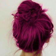 hot pink hair dye. messy bun