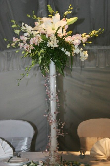 A beach inspired wedding centerpiece features a white