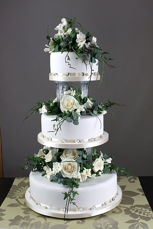 wedding cakes with separated tiers  and flowers in between  Cake obsession  Pinterest