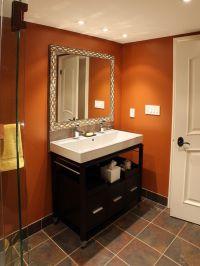 Half bath idea? Warm terracotta walls, dark tile floor ...