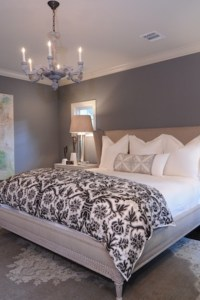 grey paint on the walls. white bedding. clean and simple