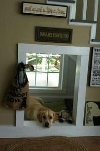 Dogs are people, too, which is why your dog should probably get his or her own little haven underneath the stairs. | 31 Insanely