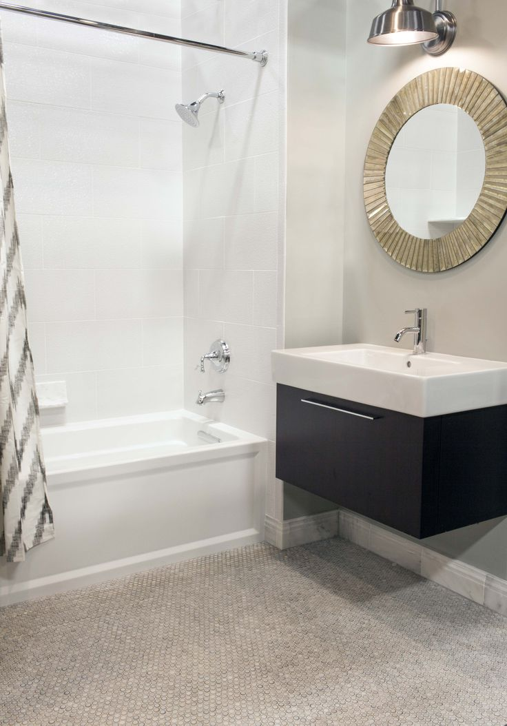 Penny for your thoughts This modern bath features glossy white dimensional wall tile and penny