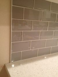 Smoke Glass Backsplash with Metal Edging