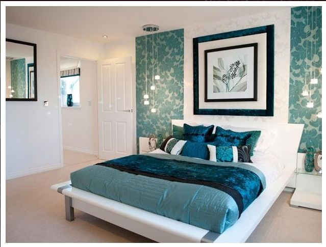 Beautiful colours in this bedroom with navy blue aqua and