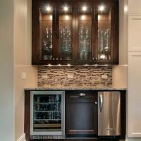 small wet bar with mini fridge, sink, overhead glass ...