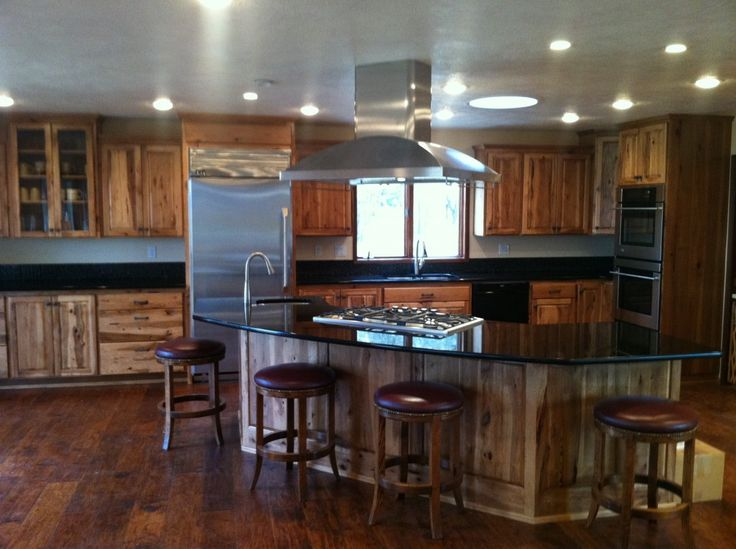 light hickory cabinets black countertops    Premium